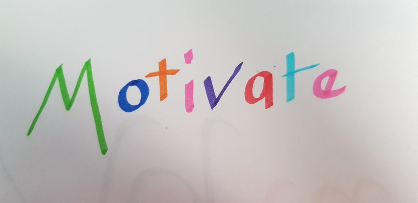 the word motivate in rainbow coloured felt tips.