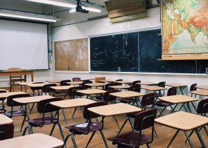 a classroom full of desks and a blackboard